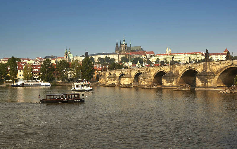 Boats at the Charles Bridge in the Vltava river